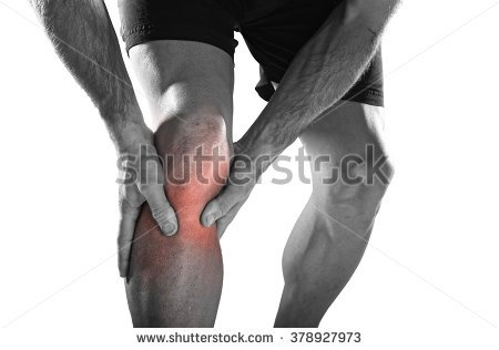 stock-photo-young-sport-man-with-strong-athletic-legs-holding-knee-with-his-hands-in-pain-after-suffering-378927973.jpg